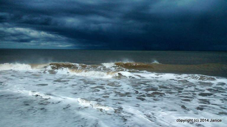 Very stormy sky and sea on the east coast of England on a bank holiday weekend. © 2014 Janice